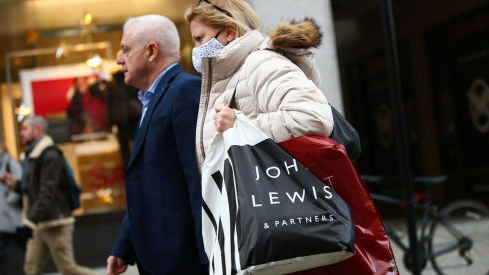 Woman carrying John Lewis bag