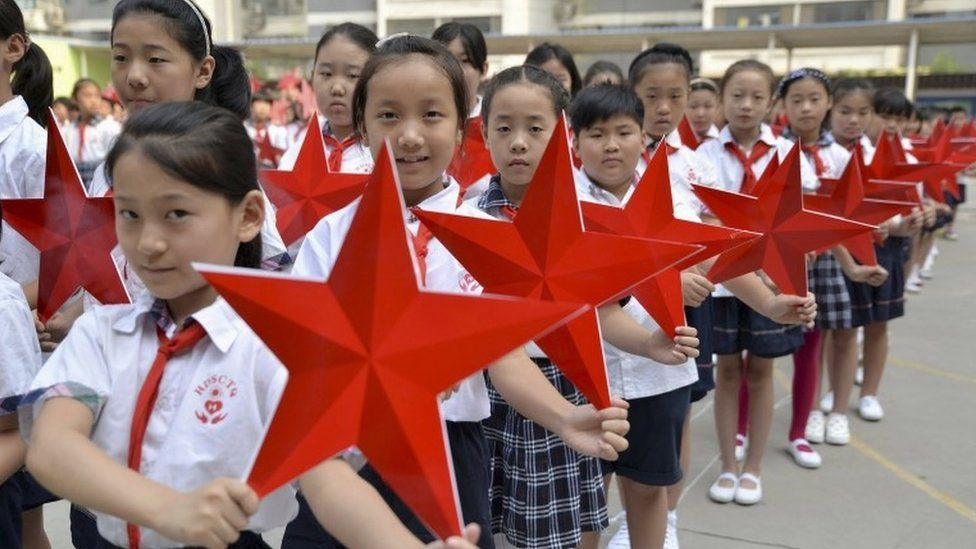 "Students pose with red stars during an event to mark the 70th anniversary of the Victory of Chinese People""s War of Resistance Against Japanese Aggression and the World Anti-Fascist War, at a primary school in Handan, Hebei province, China, August 31, 2015."