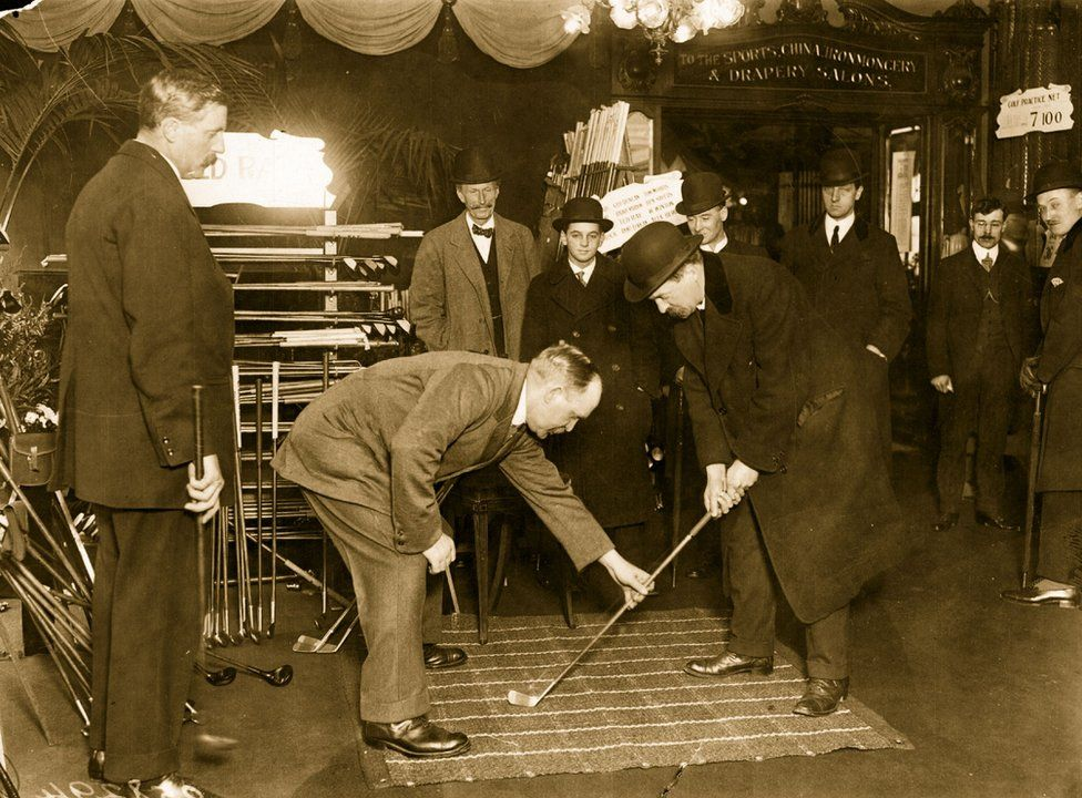 Golf champion John Henry Taylor instructing customers at Harrods in 1914
