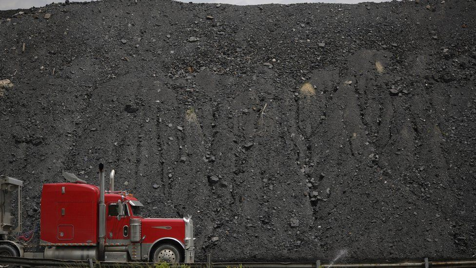 A tractor trailer drives by a mound of coal after delivering a truckload of coal to Arch Coal Terminals June 3, 2014 in Cattletsburg, Kentucky. New regulations on carbon emissions proposed by the Obama administration have reportedly angered politicians on both sides of the aisle in energy-producing states such as Kentucky and West Virginia