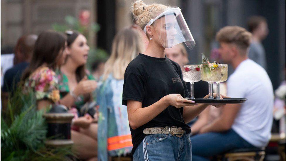 Waitress wearing PPE