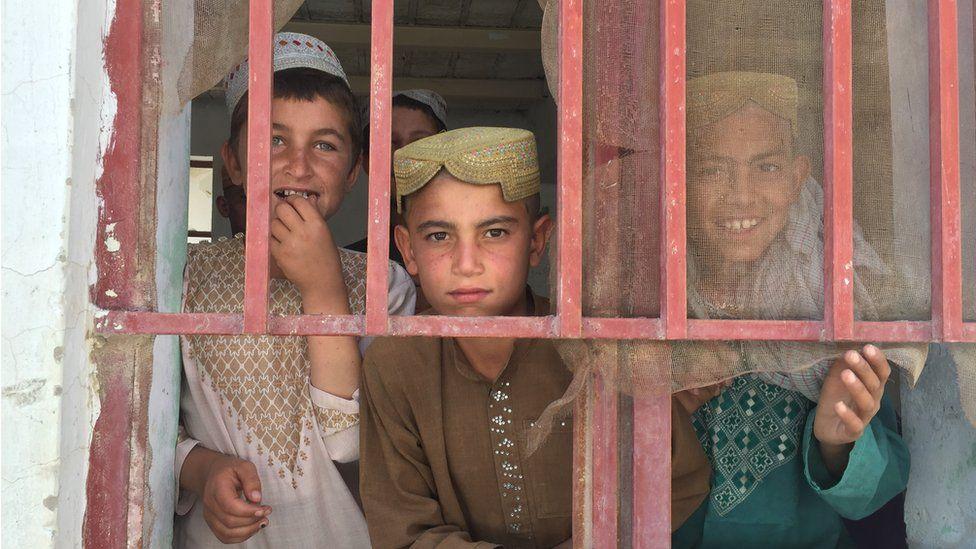Children seen through the window in Musa Qala
