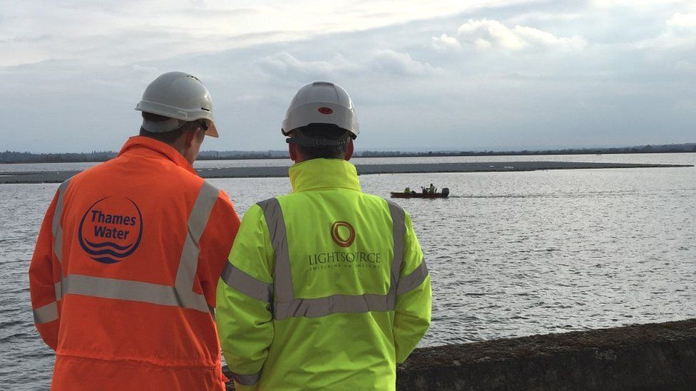 Conor McGuigan of Lightsource and Angus Berry of Thames water looking at solar farm