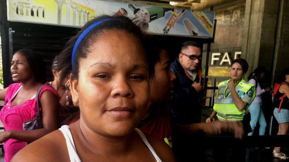 Majorie speaks to the BBC outside a supermarket in Caracas