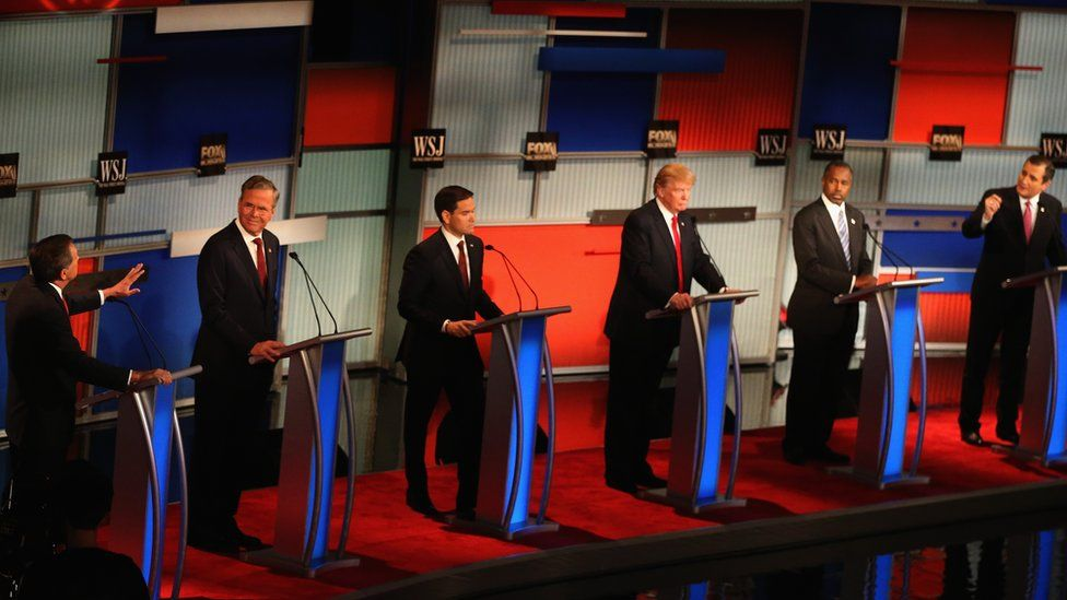 Presidential candidates Ohio Governor John Kasich (L-R), speaks while Jeb Bush, Sen. Marco Rubio (R-FL), Donald Trump, Ben Carson, and Ted Cruz (R-TX) take part in the Republican Presidential Debate sponsored by Fox Business and the Wall Street Journal at the Milwaukee Theatre November 10, 2015 in Milwaukee, Wisconsin.