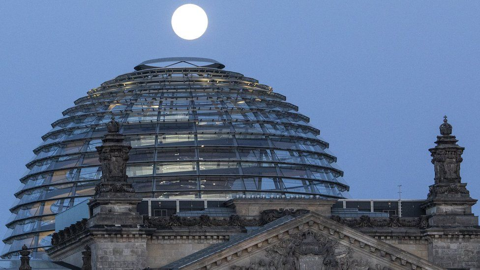 Supermoon shines over the Reichstag Building in Berlin, Germany