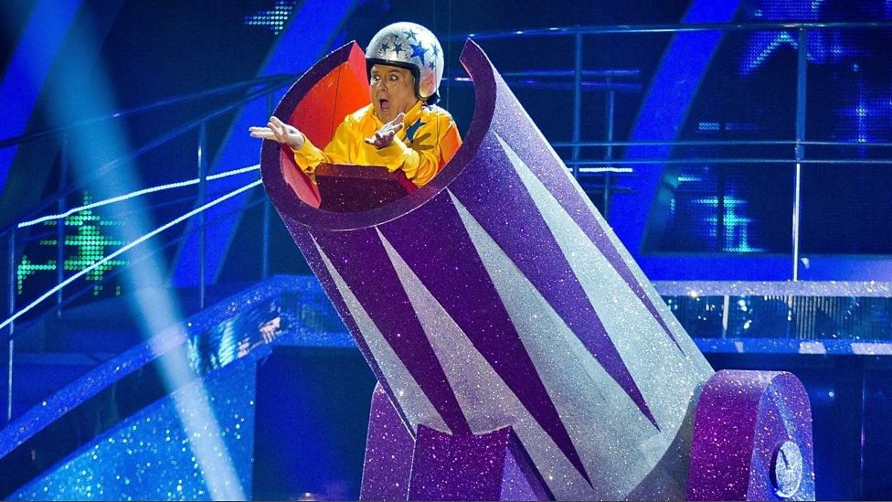 Russell Grant playing a human cannonball