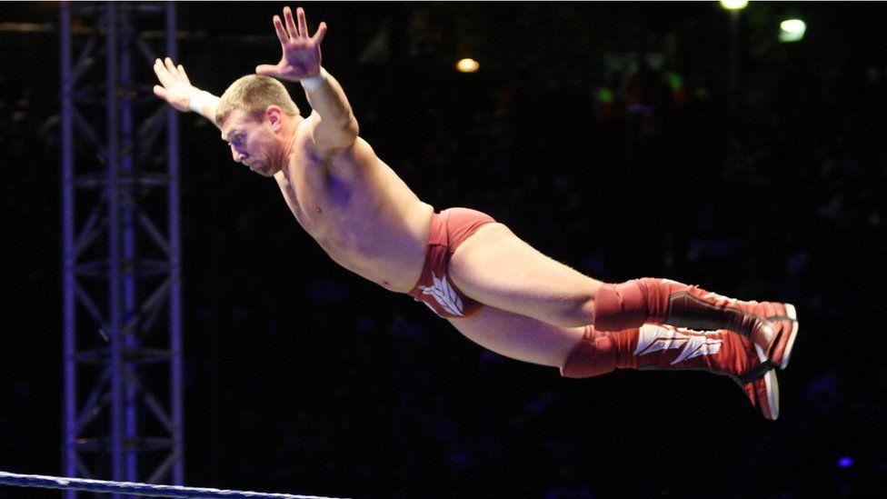 Wrestler in mid-air