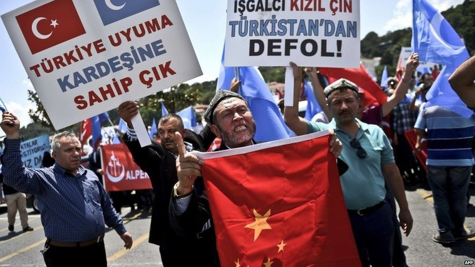 Turkish nationalists holds placards reading 'Turkey save your Brother-China get out from east Turkestan'