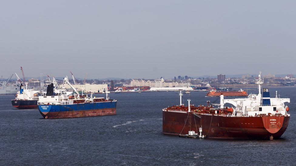 Cargo ships gather in New York harbour, in New York, New York, USA