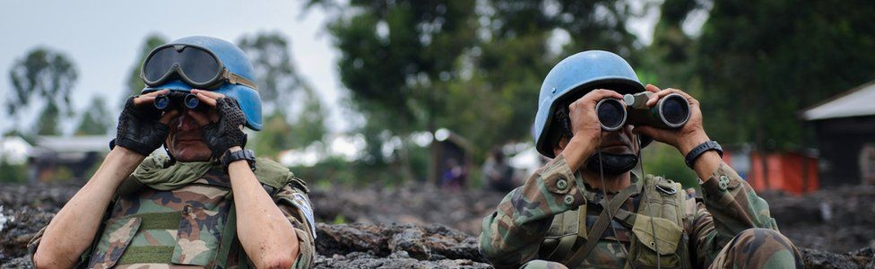 Peacekeepers of the UN mission in DR Congo surveying the horizon with binocs