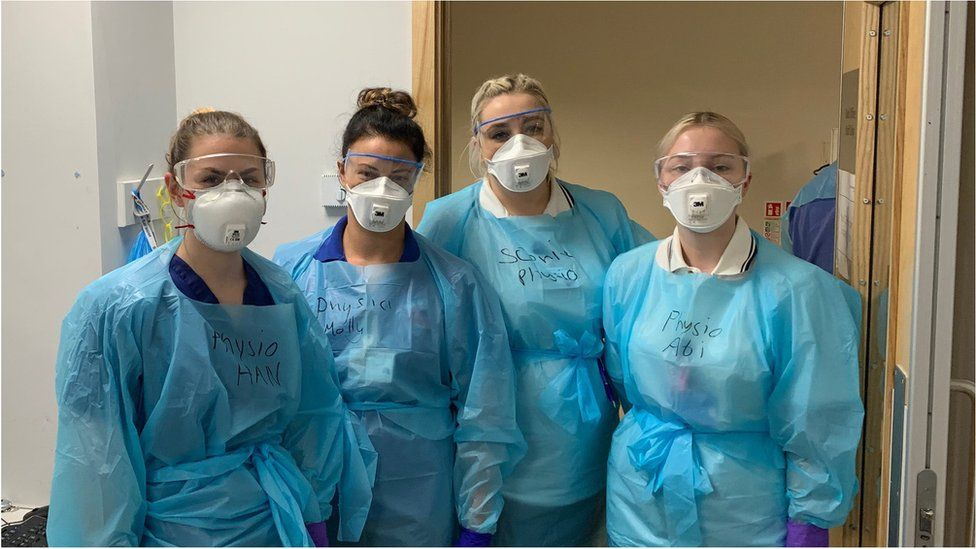 Four of our physios, masked and goggled for action