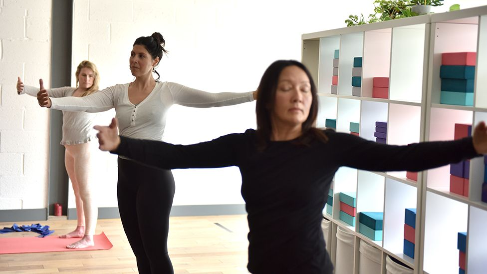 A group of women take part in an indoors yoga class at Anahata, heart centred and nurturing Wellbeing Studio on May 17, 2021 in Leigh -on-Sea, England.