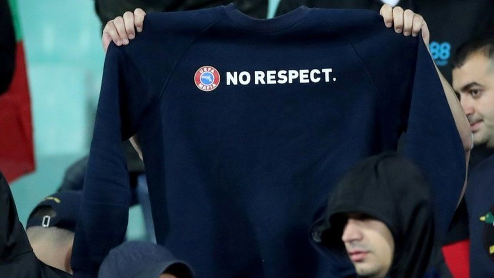 """Bulgarian fans hold up a """"No respect"""" jumper"""