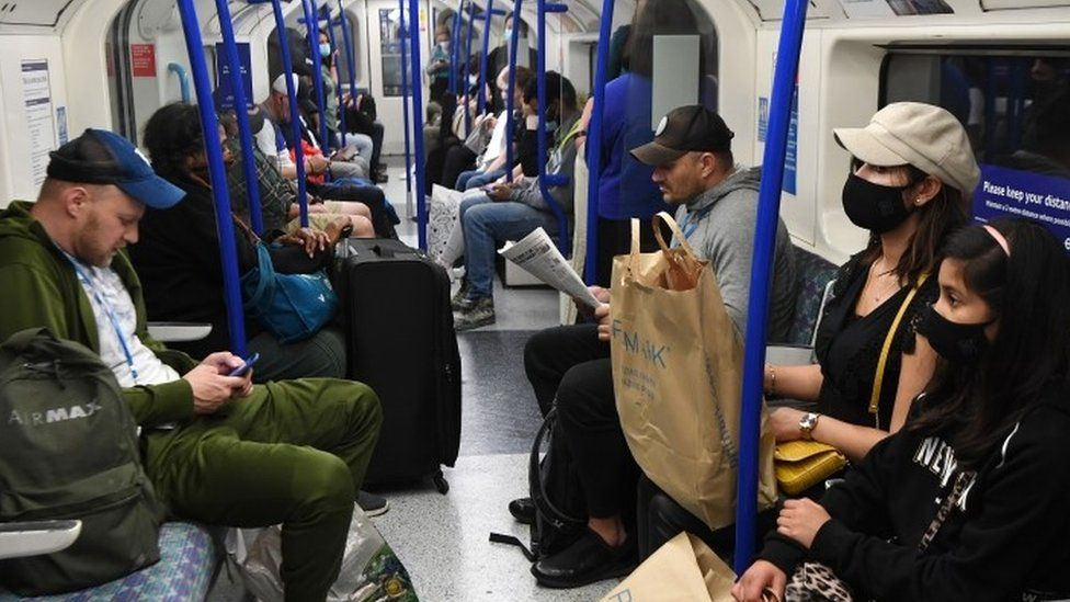 People wearing face masks on the Tube