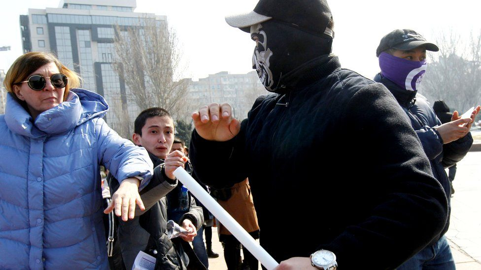 Masked men attack women participating in a march in the Kyrgyzstan capital, Bishkek