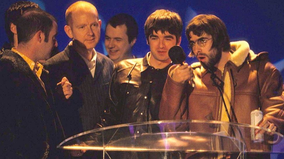 Oasis and Alan McGee at the Brit Awards in 1996