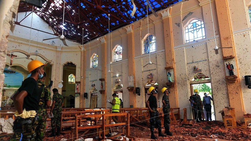 "Security personnel inspect the interior of St. Sebastian""s Church in Negombo"
