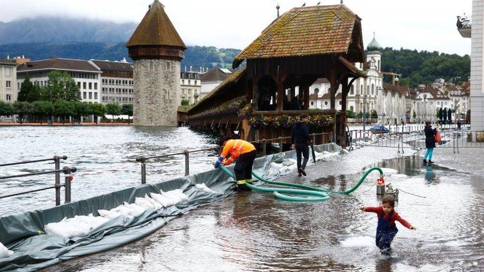 A mobile flood barrier is seen along the Reuss River in front of the Kapellbruecke bridge in Lucern