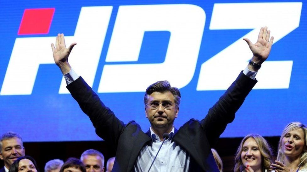 Andrej Plenkovic, president of Croatian Democratic Union (HDZ), waves to his supporters during an election rally in Zagreb (08 September 2016)
