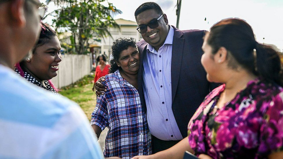 Irfaan Ali with wife and supporters in Leonora