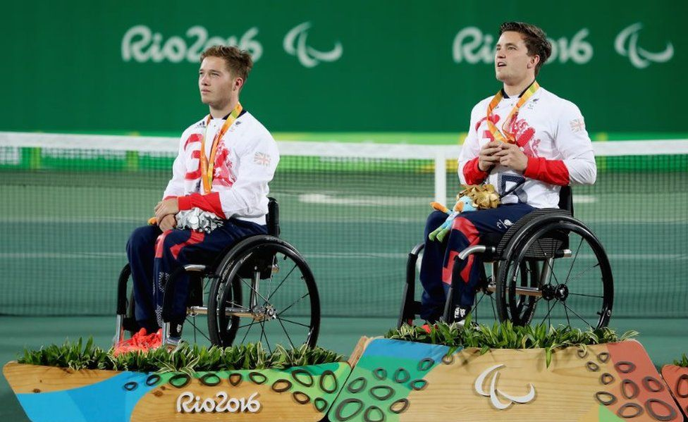 (L-r) Silver medallist Alfie Hewett and gold medallist Gordon Reid of Great Britain at the medal ceremony for the Men's Singles Wheelchair Tennis at the Rio 2016 Paralympic Games