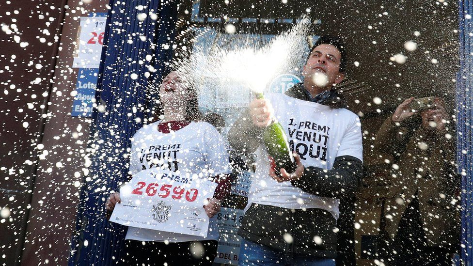 """Laura Puentes and her husband Pablo celebrate selling the winning ticket of the biggest prize in Spain's Christmas lottery """"El Gordo"""" (The Fat One) in Barcelona, 22 December, 2019."""