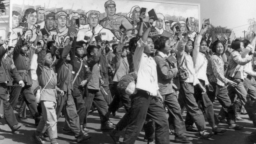 Red Guards, high school and university students, waving copies of Chairman Mao Zedong's Little Red Book in 1966