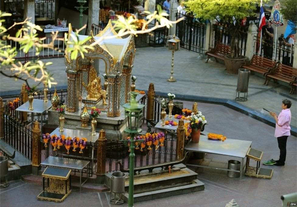 A woman prays to Hindu god Brahma at the sacred Erawan Shrine, hours before it will reopen to the public, two days after a bomb detonated on 17 August, in central Bangkok, Thailand, 19 August 2015
