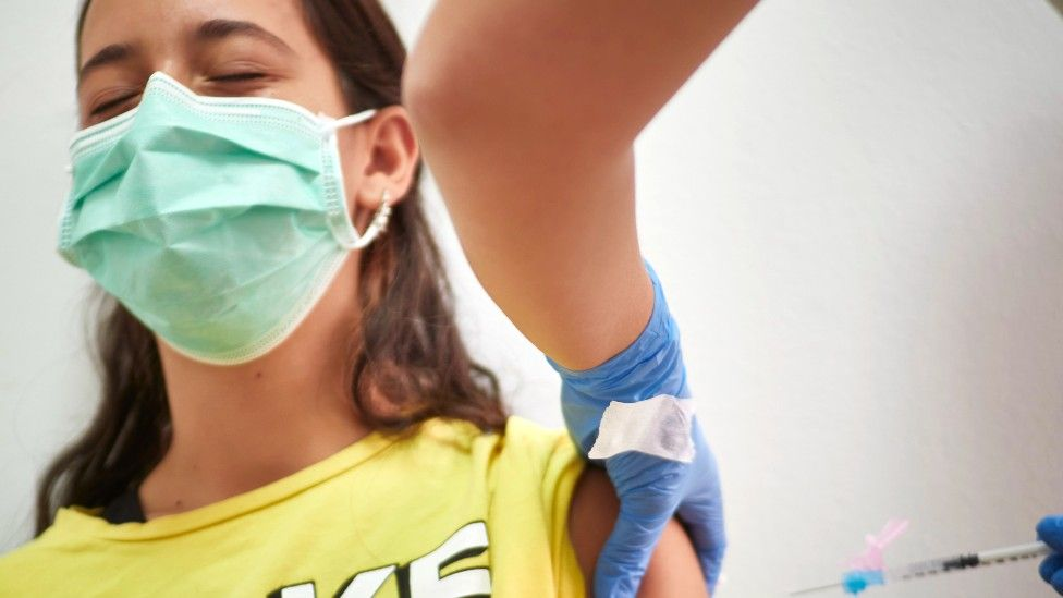 Teenager in Spain receiving the Covid vaccine