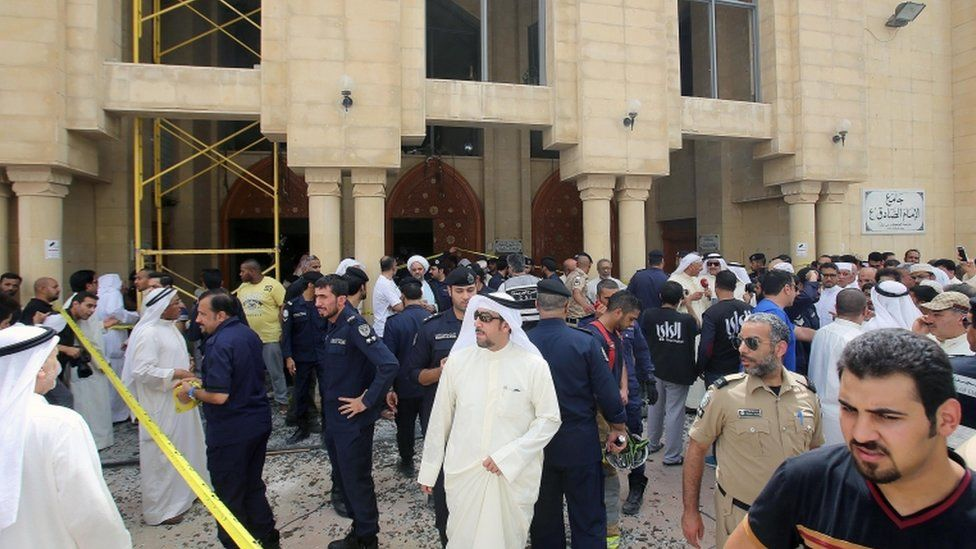Kuwaiti security forces gather outside the Shiite Al-Imam al-Sadeq mosque after it was targeted by a suicide bombing during Friday prayers on 26 June 2015, in Kuwait City