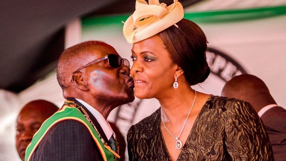 President Robert Mugabe kisses his wife and first lady Grace Mugabe during during the country's 37th Independence Day celebrations at the National Sports Stadium in Harare April 18, 2017