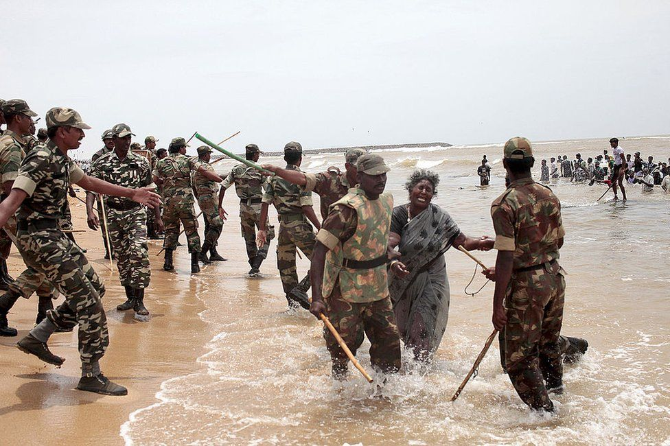 Indian police clash with protestors on the beach at Idinathakarai village near the Kudankulam Nuclear Power Plant in southern Tamil Nadu on September 10, 2012. Police in a southern Indian state shot dead a fisherman and clashed with with activists who were protesting the start of work at a nuclear power plant, officials said.