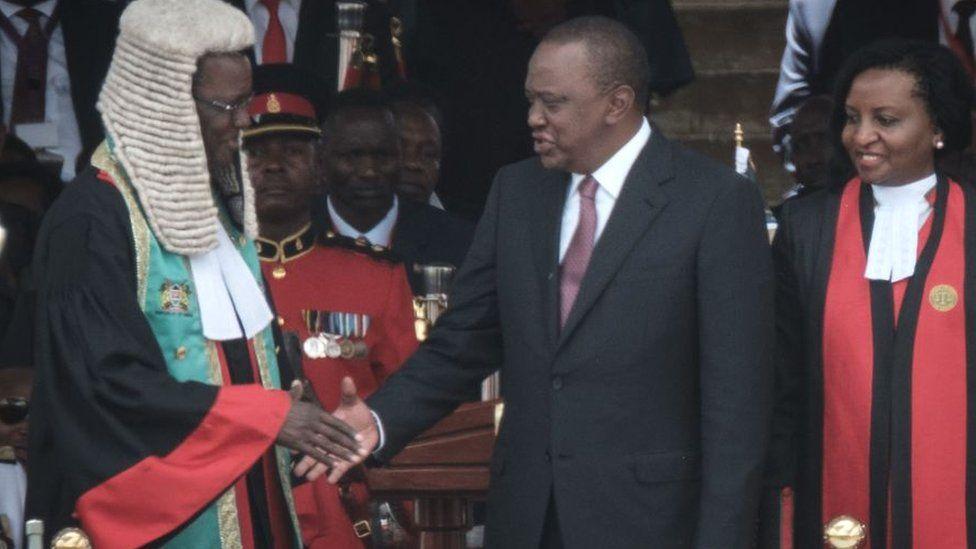 Kenya's President Uhuru Kenyatta (C) shakes hands with Kenyan Chief Justice David Maraga (L) after taking oath of office during the inauguration ceremony at Kasarani Stadium in Nairobi, Kenya - 28 November 2017