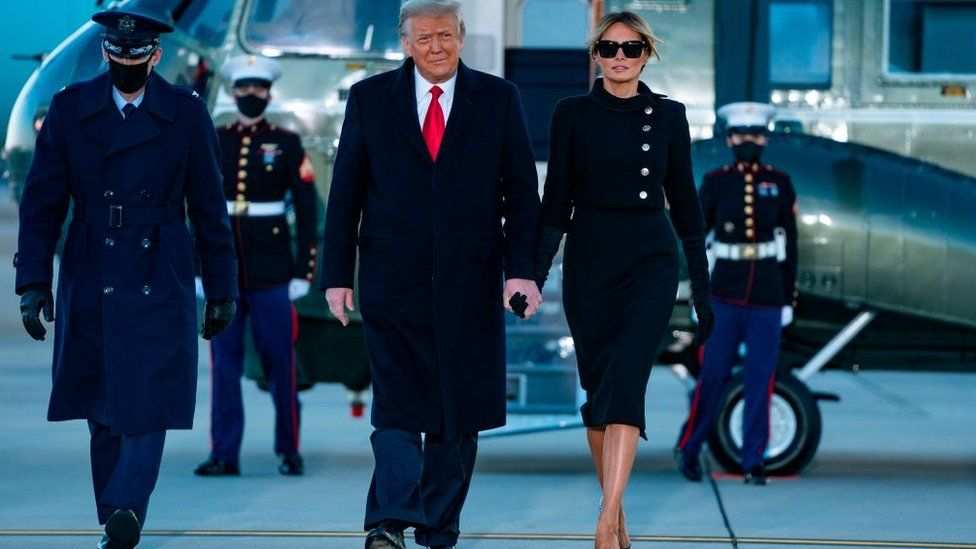 Outgoing US President Donald Trump and First Lady Melania Trump step out of Marine One at Joint Base Andrews