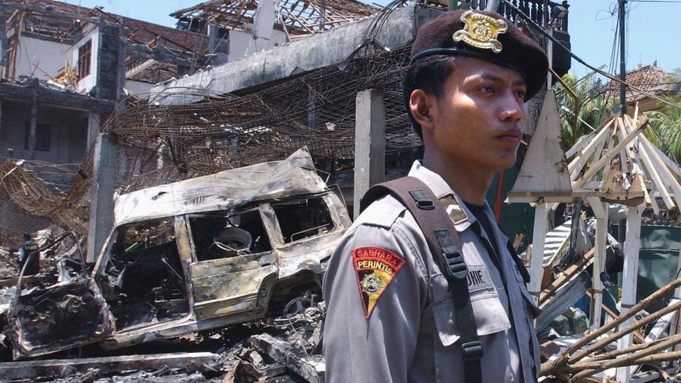 The destroyed remains of a nightclub following a bomb blast in Denpasar, on the Indonesian island of Bali, 13 October 2002