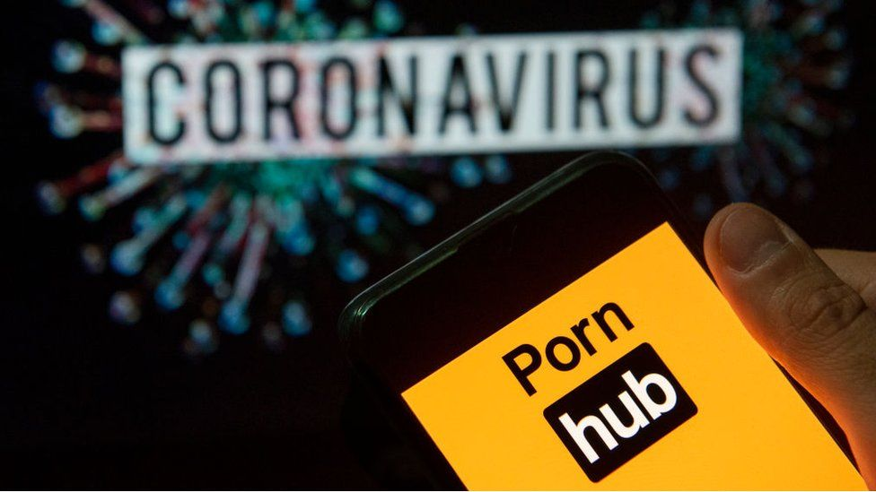 Pornhub logo on phone in front of the word cornonavirus