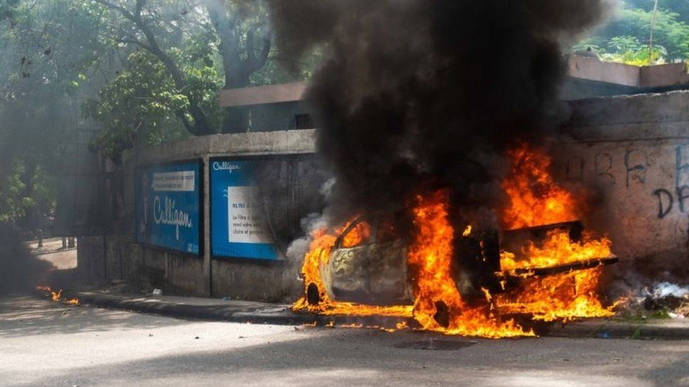 One of a number of cars set on fire during anger over the killing