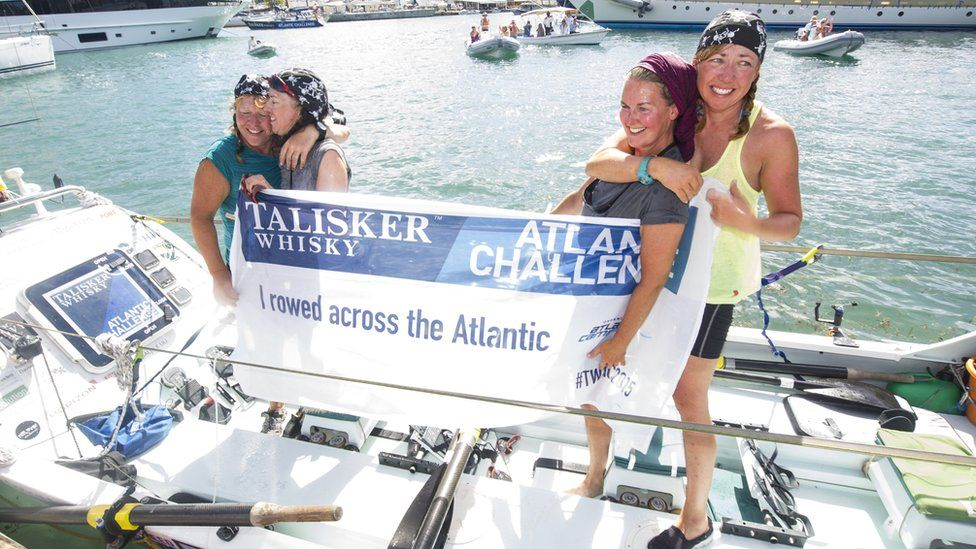 Niki Doeg, 45, Helen Butters, 45, Frances Davies, 47, and Janette Benaddi, 51, holding up a banner onboard their boat