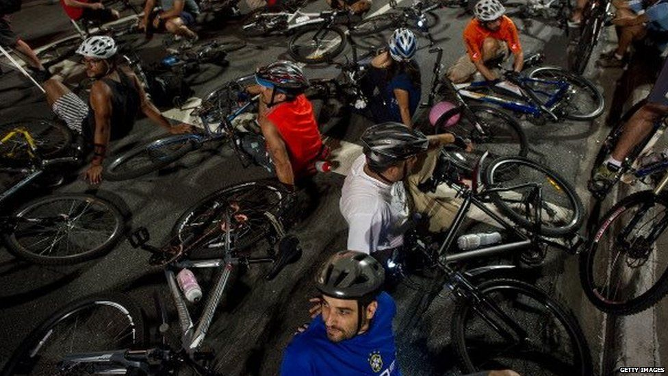 Dozens of cyclists lie on the ground on Paulista Avenue during a demonstration in Sao Paulo on 6 March, 2012
