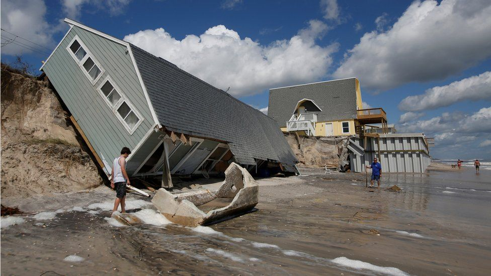 Residents return to collapsed coastal homes after Hurricane Irma passed the area in Vilano Beach, Florida, 12 September 2017
