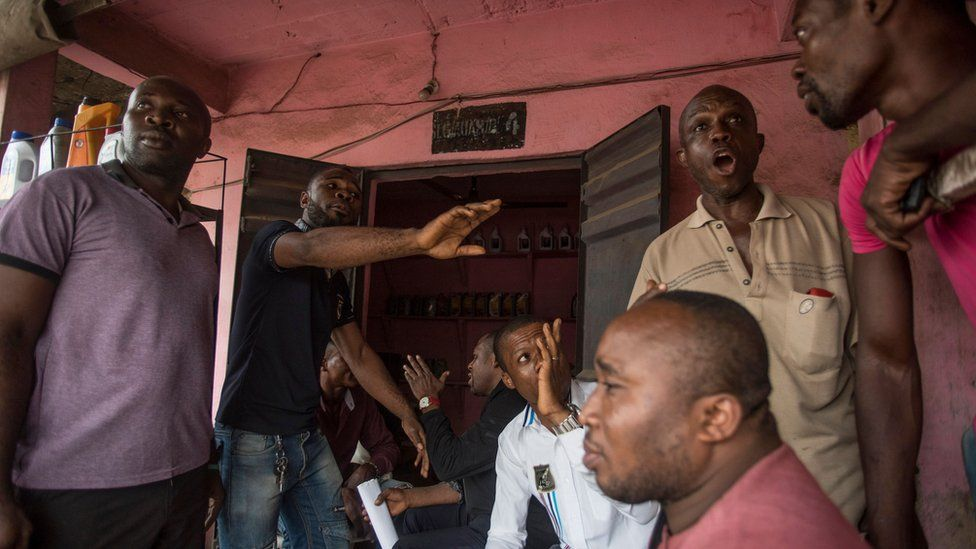 Men discussing the election in Aba, Nigeria - Thursday 14 February 2019