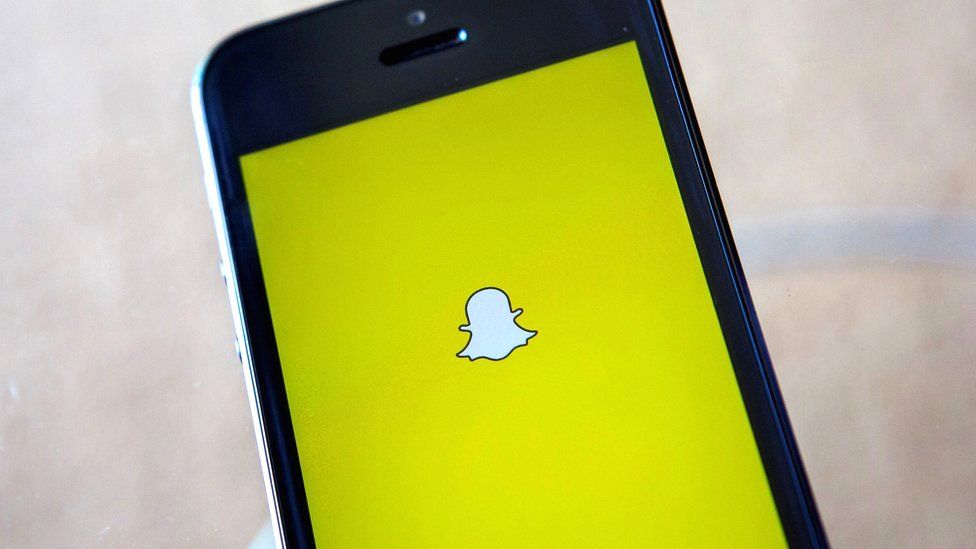 A portrait of the Snapchat logo on an iPhone