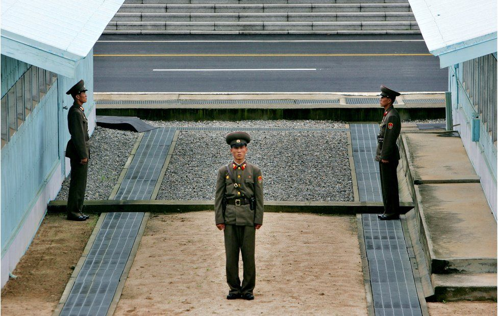 A North Korean soldier stands next to the demarcation line in Panmunjom, on the border between North Korea and South Korea Tuesday 7 Aug 2007