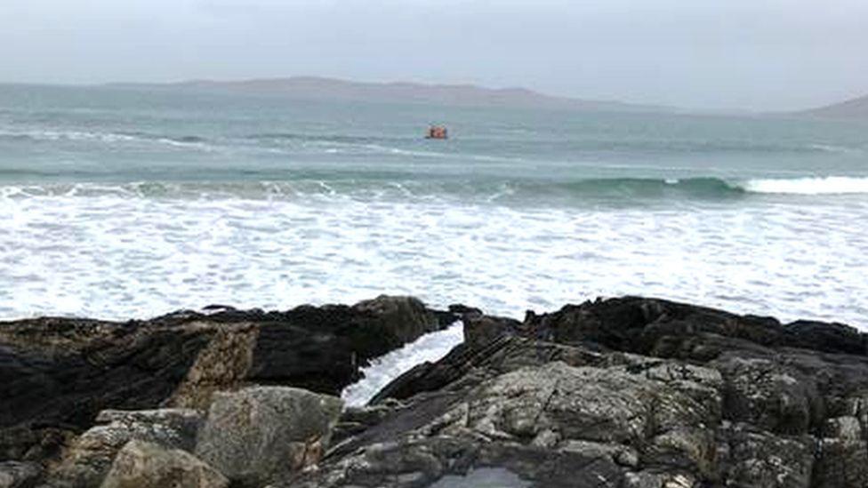 Woman swept into sea