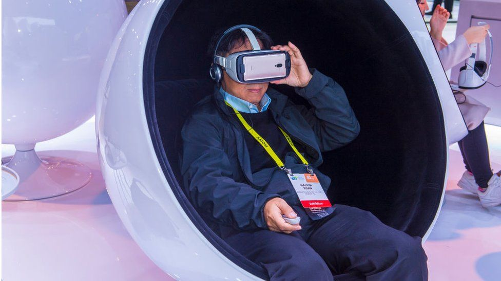 Man wearing VR headset at a trade show