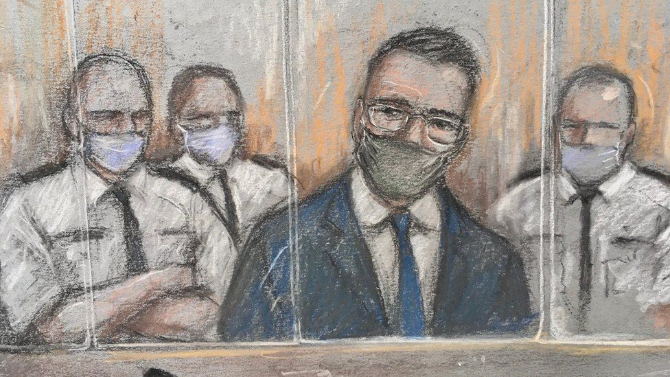 Artist sketch of defendant Pawel Relowicz flanked by court security guards in the dock