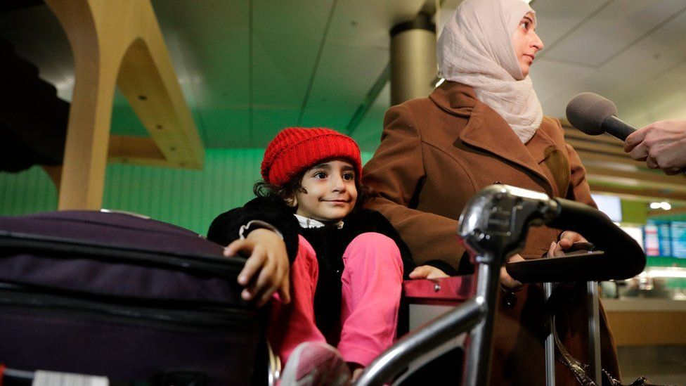 A Yemeni woman and her three year old daughter arrive at Los Angeles International Airport on 8 February, after being stranded due to the travel ban
