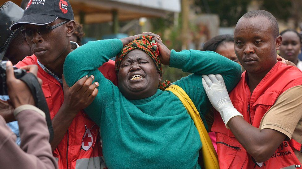 A relative of a victim of the 2015 Garissa college massacre weeps in a Nairobi morgue