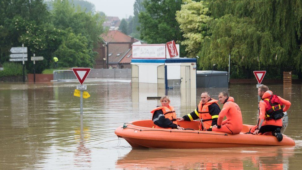 Firefighters in a dinghy in Bruay-la-Buissiere, near Lens, northern France, 31 May
